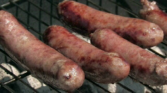 Bockwurst, sausage cooking on a grill   Stock Footage