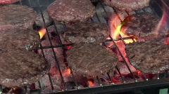 Hamburgers cooking on a barbeque grill  Stock Footage