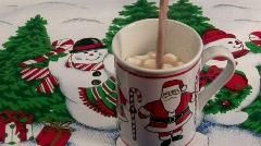 Hot Chocolate in a Christmas Santa Mug - stock footage