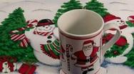 Stock Video Footage of Hot Chocolate in a Christmas Santa Mug