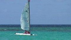 Stock Video Footage of jm206-DR-Sailboating Past Shipwreck