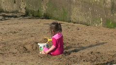 Girl making Sandcastle Stock Footage
