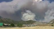 Fire over mountains freeway traffic HD Stock Footage