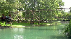 Train park crossing bridge side Stock Footage