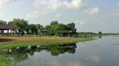 Park near lake reflections HD Stock Footage