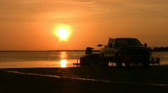 Sunset fishing boat launch truck HD Stock Footage