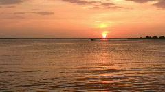Waterski across lake at sunset HD Stock Footage