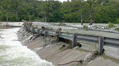 Flooded road guard rails junk HD Stock Footage