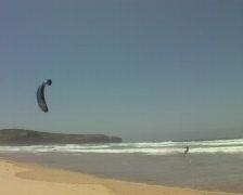 Kitesurfing in the ocean waves Stock Footage