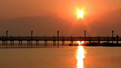 Fishing pier reflection sunset HD Stock Footage