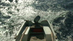 Motor boat being towed behind a ship. HD 1080i Stock Footage