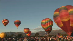 Hot air balloons ascending - pan - stock footage