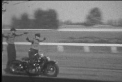 Duo motorcycle stunt ride-From 1940's film Stock Footage