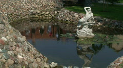 Old statue in a pool Stock Footage