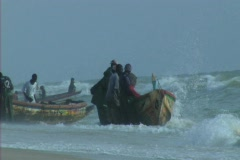 Fishermen in Africa working with canoe Stock Footage