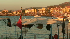 Fishing boats in harbor at sunrise with sound. HD 1080i Stock Footage