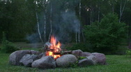 Stock Video Footage of Burning fire in outdoors fireplace 14