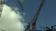 Stock Video Footage of Large construction tower cranes. HD 1080i