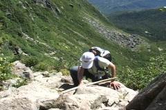 Woman climbing Mount Washington Stock Footage