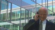 Elderly manager calling Stock Footage