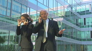 Stock Video Footage of two managers on the phone