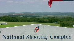 National Shooting Complex sign flags Zoom out HD Stock Footage