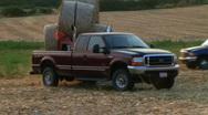 Trucks Hauling Hay Bales Stock Footage