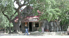 Luckenbach Texas Post Office woman walking by HD Stock Footage