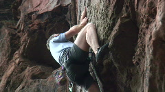 Rock climbing with rope and carabiner - stock footage