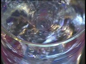 Close-up of liquid whirl in glass motion background Stock Footage