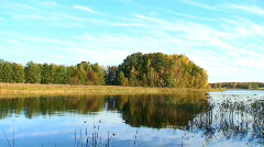 Calm freshwater lake during an autumn day in Sweden Stock Footage