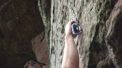 Rock climbing with rope and carabiner Stock Footage