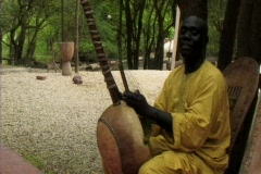 Senegalese man playing instrument and singing ws - stock footage
