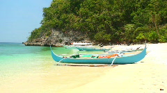 Traditional filipino Banka outrigger boat laying on a beach in Philippines Stock Footage