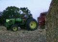 Farmer Round Baling Hay Footage