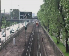 Train next to highway (Buenos Aires) - Timelapse - stock footage