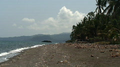 Black sand beach and mountains in the background in the Philippines Stock Footage