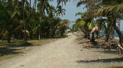 Road next to the ocean in the small village of Melgar in the Philippines Stock Footage