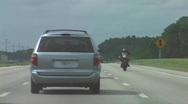 Stock Video Footage of Reckless Driving - Biker Does Wheelie On The Interstate