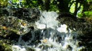 Stock Video Footage of extreme close top of waterfall wider