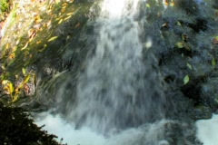Water sliding to bottom of rock Stock Footage