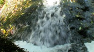 Stock Video Footage of Water sliding to bottom of rock