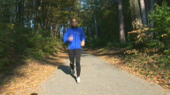 Female runner in autumn Stock Footage