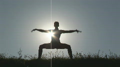 Woman stretching at sunset - straddle Stock Footage