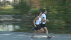 Two athletes running close Stock Footage