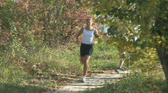 two athletes running along path - stock footage