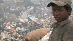 Boy works at dump in Phnom Penh Stock Footage