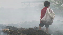 Stock Video Footage of Boy works at dump in Phnom Penh