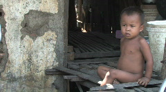 Boy living in poverty in slum of Phnom Penh, Cambodia Stock Footage
