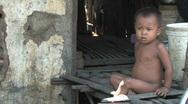 Boy living in poverty in slum of Phnom Penh, Cambodia Stock Footage